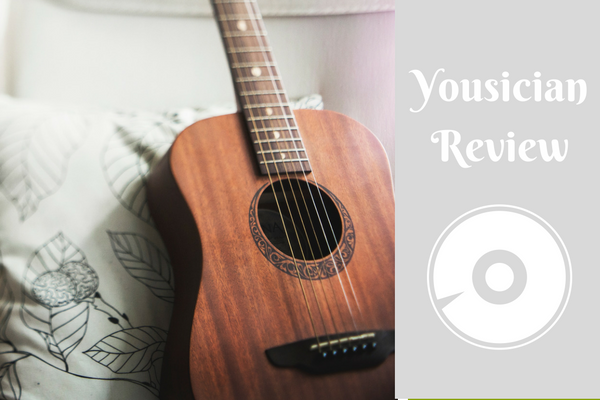 classical guitar on pillow yousician review graphic