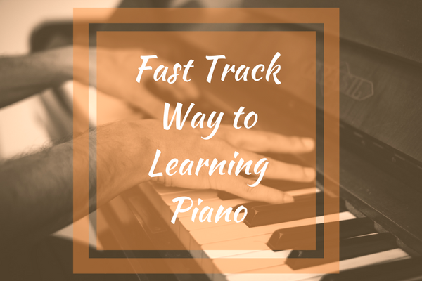 Piano with Fast Track way to learn piano graphic in front of it